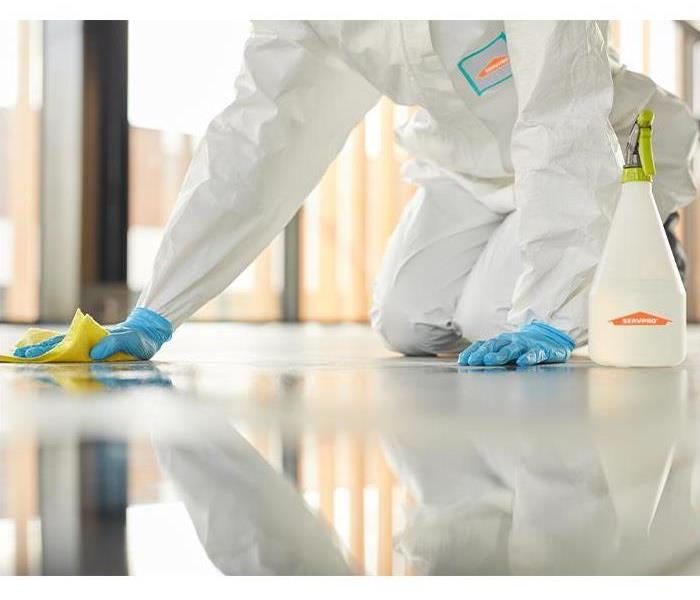 SERVPRO employee disinfecting floor
