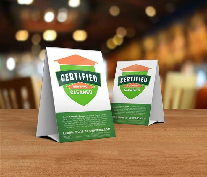 Certified: SERVPRO Cleaned table toppers on table inside business