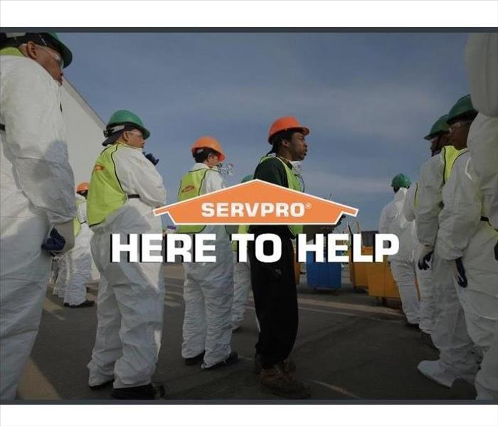 SERVPRO employees getting ready to walk into disinfecting job