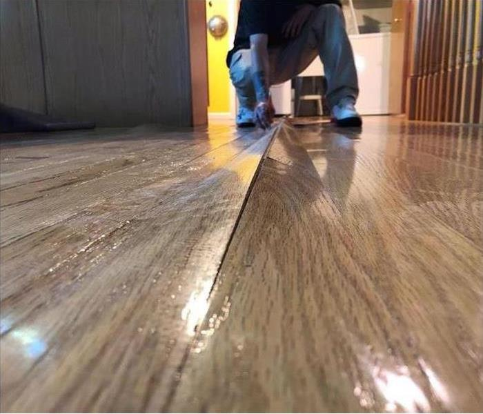 Close up of water damage on a wood floor