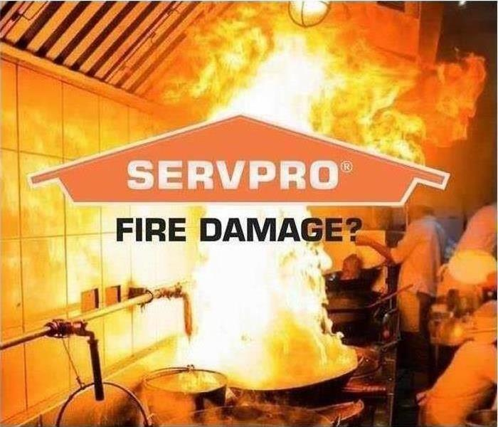 Fire on kitchen stove with SERVPRO logo