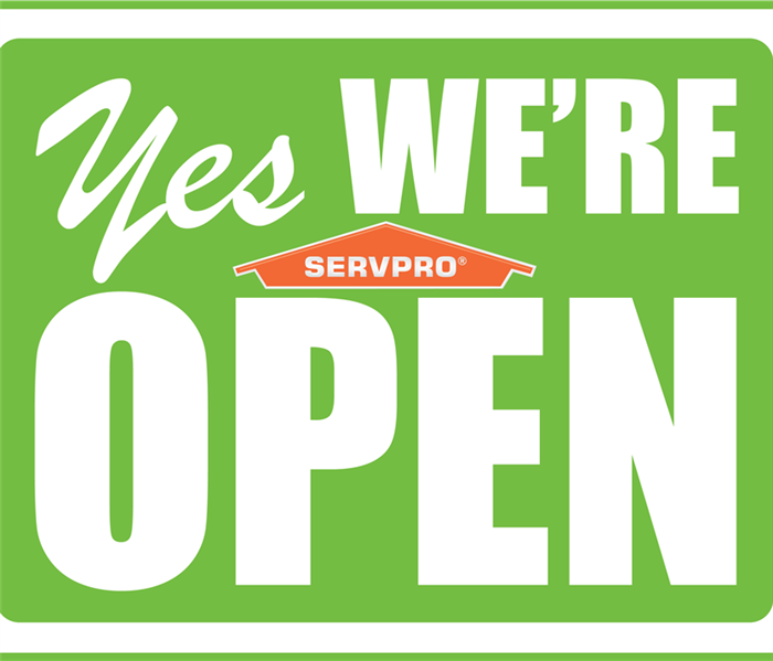 """Yes We Are Open"" with SERVPRO logo"
