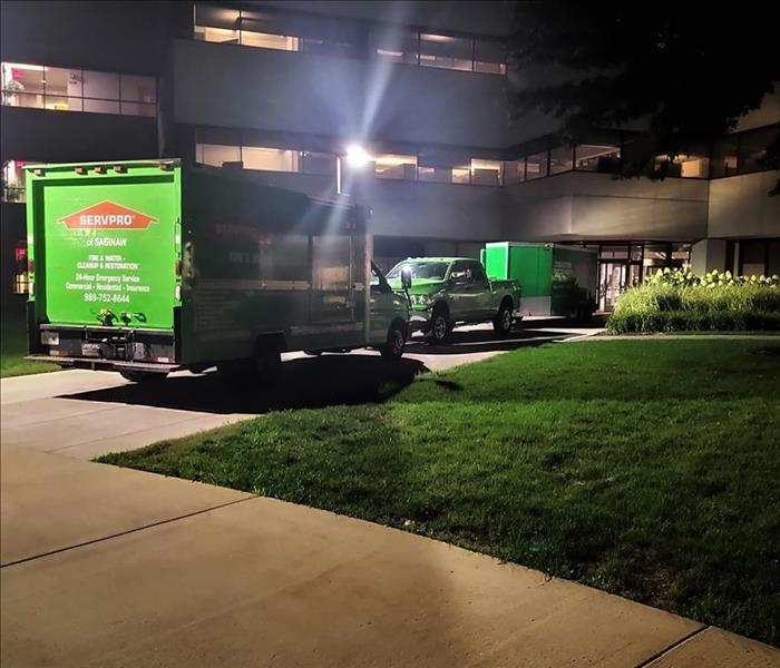 SERVPRO trucks outside of commercial building