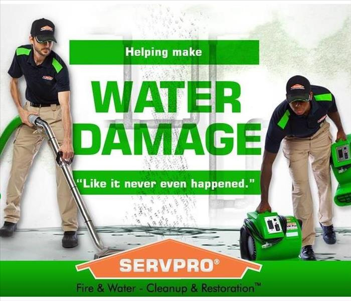 SERVPRO employees retracting water