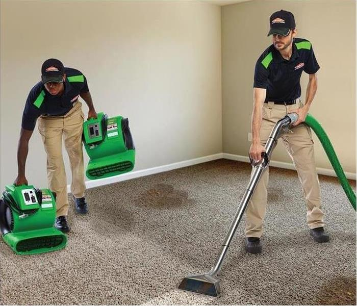 Two male SERVPRO employees cleaning carpet