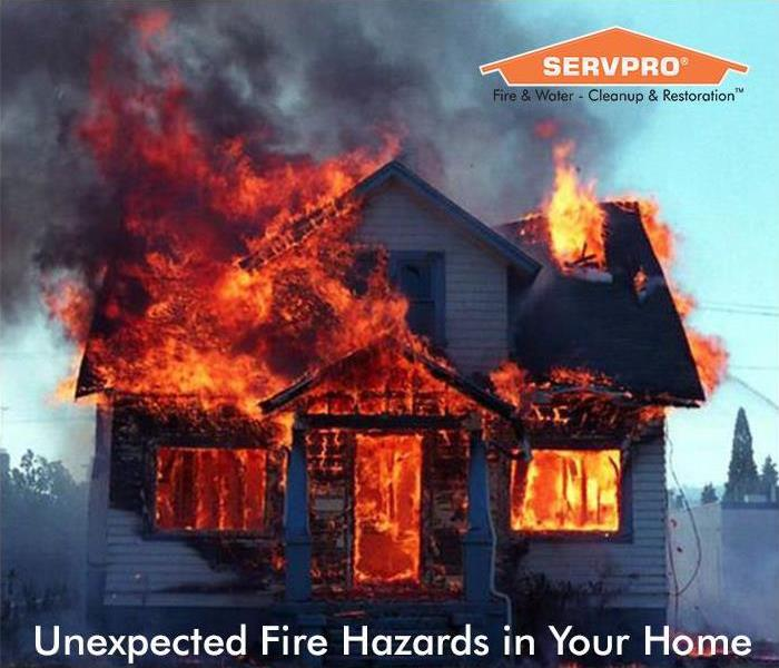 Home on fire with SERVPRO logo